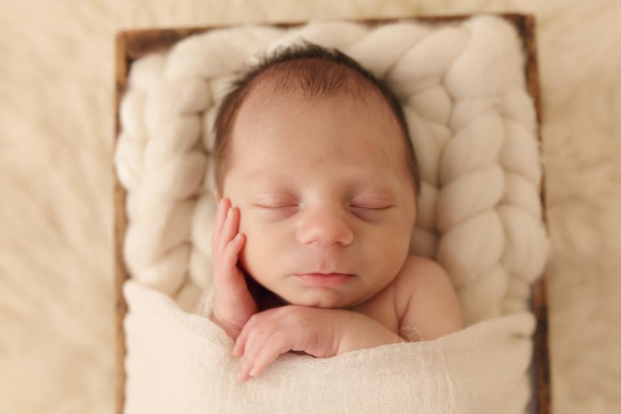 Newborn photoshoot at Waukesha's premiere newborn photography studio.